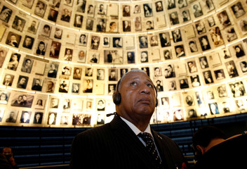 Fiji's Prime Minister Josaia Voreqe Bainimarama looks at pictures of Jews killed in the Holocaust during a visit to the Hall of Names at Yad Vashem's Holocaust History Museum in Jerusalem
