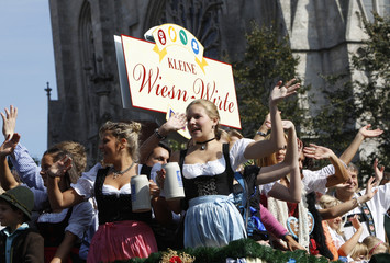 People in traditional Bavarian clothes take part in Parade of the Landlords and Breweries during the opening of 177th Oktoberfest in Munich