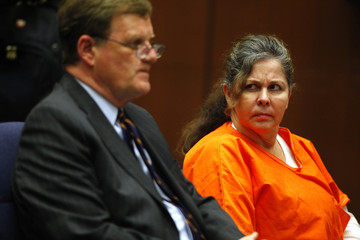 Former Bell assistant city administrator Angela Spaccia looks toward her attorney Harland Braun while they listen to public remarks before her sentence is handed down in Los Angeles Superior Court