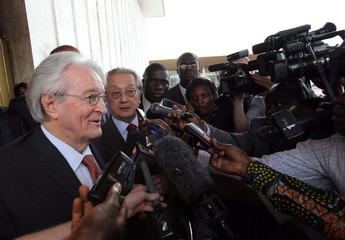 Former French foreign minister Dumas and French lawyer Verges talk with journalists after meeting incumbent Ivory Coast leader Gbagbo in Abidjan