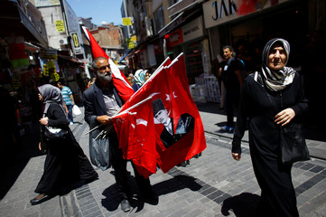 A street vendor sells national flags at Mahmutpasa street, a middle-class shopping area, in Istanbul