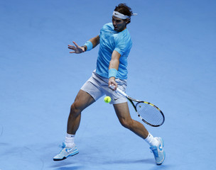 Rafael Nadal of Spain hits a return to Tomas Berdych of the Czech Republic during their men's singles tennis match at the ATP World Tour Finals at the O2 Arena in London