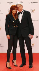 Berg and husband Ferber arrive on red carpet for Bambi 2013 media awards ceremony in Berlin