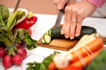 Woman slicing vegetables
