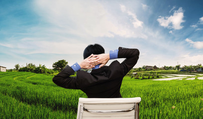 Businessman stretching arm for relax with cityscape view in sunrise, panoramic for web banner