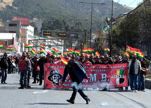 A mine worker throws a dynamite stick during a protest called by the Bolivian Union Workers (COB) in La Paz