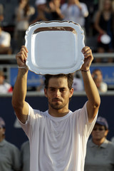 Girald of Colombia lifted silver platter runners up trophy after being defeated by Robredo of Spain in their men's final match at the ATP World Tour Movistar Open tennis tournament in Santiago