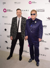 Elton John and David Furnish arrive at the Elton John AIDS Foundation Academy Awards Viewing Party in West Hollywood