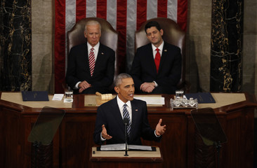 U.S. Vice President Biden and Speaker of the House Ryan look on as U.S. President Obama delivers his State of the Union address to a joint session of Congress in Washington