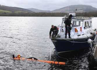 Engineers prepare to tow Munin, an intelligent marine robot, on Loch Ness in Scotland