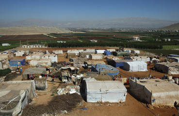 A general view shows tents at an improvised camp for Syrian refugees in Kfar Zabad in the Bekaa Valley