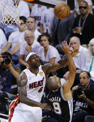 Heat's James and Spurs' Parker battle for a rebound during Game 1 of their NBA Finals basketball playoff in Miami