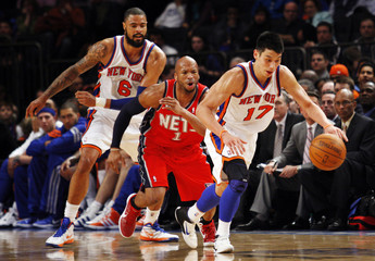 New York Knicks point guard Lin steals the ball from New Jersey Nets' Gaines during their NBA basketball game at Madison Square Garden in New York