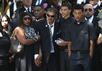 The family of slain Jersey City police officer Melvin Santiago stands by as his casket is carried into St. Aloysius Catholic Church for his funeral service in Jersey City