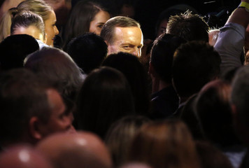 Australia's conservative leader Abbott walks past supporters after claiming victory in Australia's federal election during an election night function in Sydney