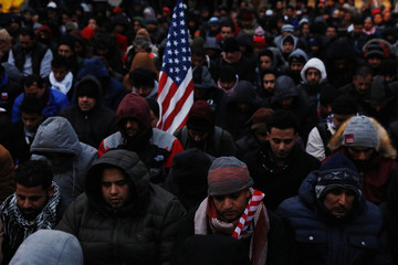 Demonstrators pray as they participate in a protest by the Yemeni community against U.S. President Donald Trump's travel ban in the Brooklyn borough of New York
