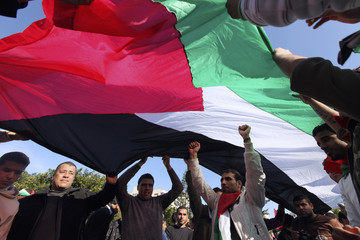 Palestinians take part in a rally in Gaza City, calling for an end to Palestinian divisions