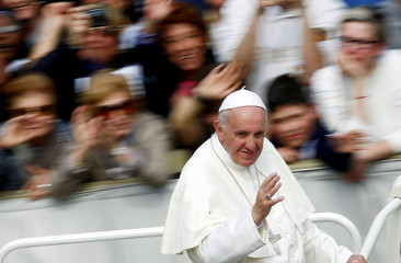Pope Francis waves as he leaves at the end of a Jubilee mass in Saint Peter's Square at the Vatican