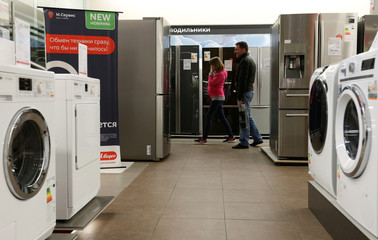 Customers walk in a store of Russia's biggest electrical and white goods retailer M.video in Moscow