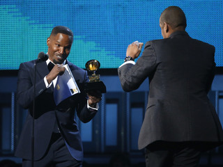 """Presenter Foxx play boxes with Jay-Z before handing over the Grammy for Best Rap Song for """"Holy Grail"""" at the 56th annual Grammy Awards in Los Angeles"""