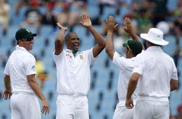 South Africa's Philander celebrates with team mates dismissal of Sri Lanka's captain Dilshan during the third day of their first test cricket match in Centurion