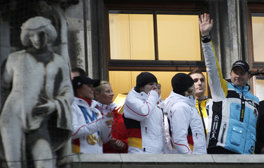 Winter Olympics 2010 German medal winners Lange and Kuske wave from the balcony during the welcoming ceremony for the German Winter Olympics 2010 team, in Munich