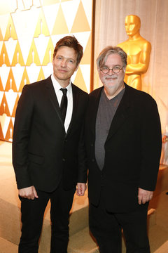 Director Vinterberg poses after receiving his nomination certificate from presenter cartoonist Groening at the 86th Academy Awards Foreign Language Nominee Reception at Ray's and Stark Bar on the LACMA Campus in Los Angeles