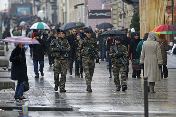 """French soldiers patrol on the Champs Elysees avenue in Paris as part of the """"Vigipirate"""" heightened security plan"""