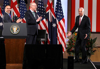 US Vice President Joe Biden reacts as he walks onto stage to deliver a speech at Sydney's Paddington Town Hall, Australia