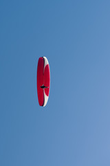 Paragliding in blue cloudy sky