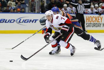 Ottawa Senators center Kyle Turris breaks away from New York Islanders defenseman Andrew MacDonald in second period NHL hockey action in Uniondale