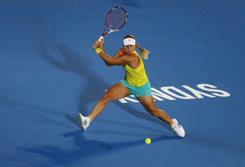 Kerber of Germany hits a return to Kuznetsova of Russia during their women's singles match at the Sydney International tennis tournament