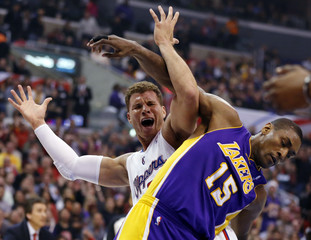 Los Angeles Clippers' Blake Griffin looks for a call against Los Angeles Lakers' Metta World Peace as they get tangled up, but a foul is called against Griffin during the first quarter of their NBA basketball game in Los Angeles