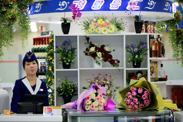A vendor waits for customers at the shop inside the international airport in Pyongyang