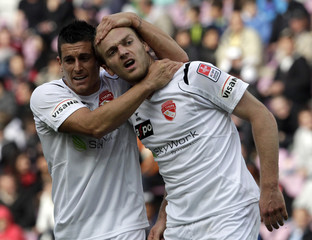 FC Thun's Schneuwly celebrates scoring a goal with team mate Hediger during their Super League soccer match against FC Servette in Geneva
