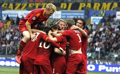AS Roma's Taddei celebrates after scoring against Parma during their Italian Serie A soccer match at the Tardini stadium in Parma