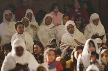 African Christian women attend Egypt's Coptic Christmas eve mass led by Pope Tawadros II in Cairo