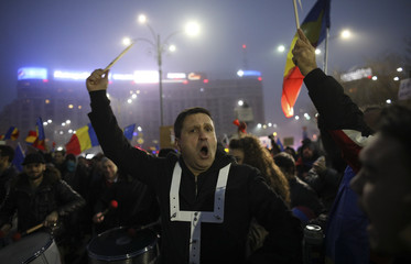 Protester plays drums during a demonstration in Bucharest