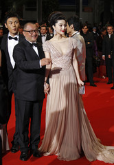 "Director Wang arrives with cast members Fan and Qing on the red carpet for ""Rizhao Chongqing"" screening at Cannes"