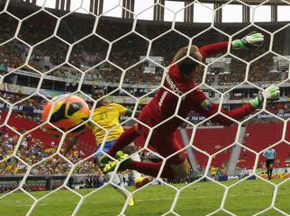 Brazil's Jo scores past Australia's goalkeeper Schwarzer during their international friendly soccer match in Brasilia