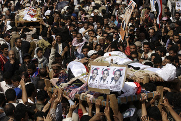 Mourners carry the coffins of anti-government protesters during a funeral in Sanaa