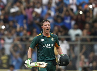 South Africa's captain de Villiers celebrates scoring his century during their fifth and final one-day international cricket match against India in Mumbai