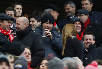 Gary McAllister and actor Will Ferrell in the stands before the match