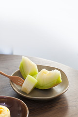Juicy slice cantaloupe melon on ceramic dish