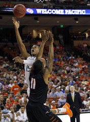 University of Miami guard Rion Brown shoots against Pacific University guard Lorenzo McCloud during the second half of their second round NCAA basketball game in Austin, Texas