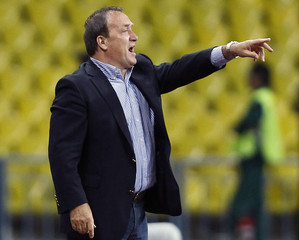 Russia coach Advocaat reacts during his team's Euro 2012 Group B qualifying soccer match against Macedonia at Luzhniki Stadium in Moscow