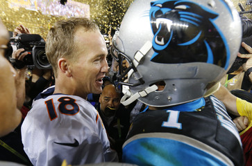 Denver Broncos' quarterback Manning and Carolina Panthers' quarterback Newton greet each other on the field after the Broncos defeated the Panthers in the NFL's Super Bowl 50 football game in Santa Clara