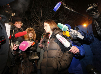 Pussy Riot member Tolokonnikova speaks to the media after she was released from prison in Krasnoyarsk