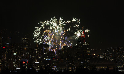 Fireworks light up the night sky during the opening ceremony of the Vancouver 2010 Winter Olympics