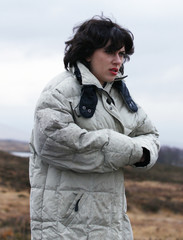 Actress Scarlett Johansson walks along a road during the filming of a scene from the movie 'Under The Skin' in Glencoe, Scotland